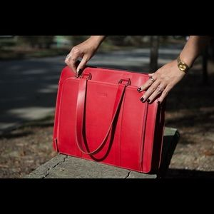 I absolutely love it but I have a similar bag.